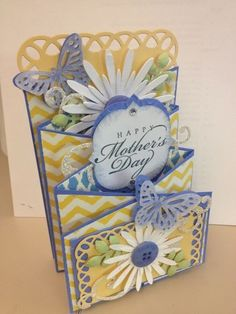 handmade card: Cascading Card for Mother's Day ... blue, yellow, white ... like the paper flowers ... beautiful card!