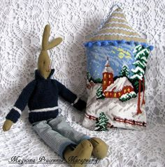 Rabbit in a sweater.  Winter house.