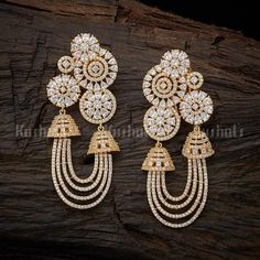 118831 Colour White Polish Gold Base Metal Copper Alloy Stone Zircon Earring Weight (gms) 32 Earring Length (cms) 7 Earring Style Hanging Earring Closure Type French Back Indian Jewelry Earrings, Indian Jewelry Sets, Jewelry Design Earrings, Gold Earrings Designs, Ear Jewelry, Bridal Earrings, Antique Earrings, Boho Jewelry, Silver Jewelry