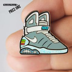 new styles 2dda4 47226 Two artists collaborated on a set of Nike Mag pins in anticipation of its  2015 release.