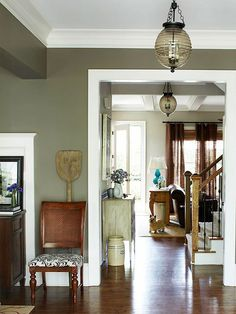 Things Are Looking Up...A subdued palette of grays and browns gives the open layout of the home a sense of cohesion. In the hallway, antique-look pendants replaced basic builder fixtures and hint at the homeowner's personal style. The beehive-shape light fixtures add plenty of vintage character at a much lower price than true antiques.