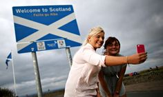 Two women take a photograph of themselves on the border. The three latest polls suggest the no campaign has a slight lead of 52% to 48% for. Photograph: Peter Macdiarmid/Getty Images