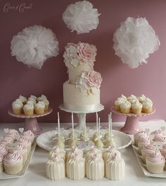I love the idea of having a small 2 tier max. wedding cake with a selection of cupcakes and cake pops for guests, seems like it would make serving so much easier.