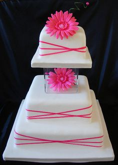 2 round tiers, white fondant, one with yellow ribbons, one with purple ribbons