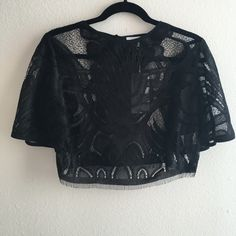 """Black lace crop top Black lace crop top by Lucy Paris. Brand new with tags. Size small. Approx 16"""" in length. No trades, no pp, no exceptions!!! Lucy Paris Tops Crop Tops"""