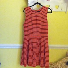 Stripped peach/orange dress It is peach/orange. It has navy blue stripes. Barely worn, great condition. It has a zipper on the back. Mossimo Supply Co. Dresses Midi