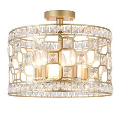 This beautiful crystal drum shaded ceiling lamp exudes class and style. Matte gold finish with inserted square cut high quality crystals embellish the entire piece. Brilliant light patterns and reflections will bathe your space when illuminated. Crystal Bedroom, Chandelier Bedroom, Bedroom Lighting, Hallway Lighting, Gold Ceiling, Ceiling Lamp, Ceiling Lights, Laundry Room Lighting, Light Scattering