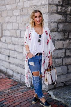 Canadian fashion and lifestyle blogger, Jackie Goldhar, wearing a casual spring outfit with a Coach bag and soludos smoking slippers
