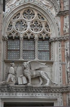 Entrance to the Palazzo Ducale  Giovanni and Bartolomeo Bon 1438 Marble  Situated on the left corner of Palazzo Ducale facing the piazzetta, ..The relation of Doge and lion of St Mark can mean several things: first, that the ruler of Venice professes his subservience to the city-state, of which the lion is the symbol; second, that he does the same before the city's patron saint, .. allegiance to the Christian Gospels ..