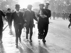 Suffragette Emmeline Pankhurst is hauled away by police after presenting a petition calling for the female vote directly to King George V Holloway Prison, Emmeline Pankhurst, Suffrage Movement, London Police, Dramatic Photos, Powerful Pictures, Right To Vote, London Museums, Photos Of Women