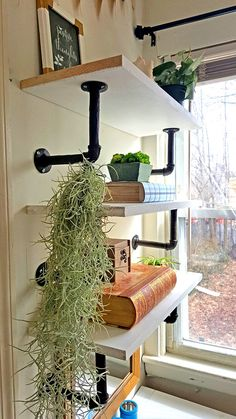 How to make industrial pipe floating shelves... so cool! By The Honeycomb Home
