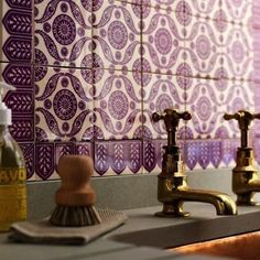 Aubergine and brass kitchen faucet and backsplash. Loving this color combo together!
