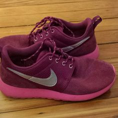 Nike roshe run Maroon and pink sole roshe runs. Has a silver Nike check. Worn a few times. Still in good condition Nike Shoes Sneakers
