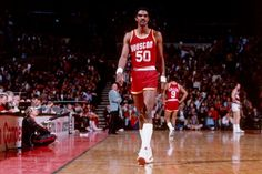 Ralph Sampson. A 7'4 monster that played with Hakeem on the Houston Rockets. Drafted in 1983 he was the first pick overall to the rockets. He wore number 50 and was a shot blocker in the paint. He did not win any NBA Championships.