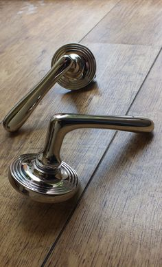 "Classic and contemporary door handles from British Ironmongery. Shown here in polished nickel and mounted on a covered, reeded rose. This smooth, elegant lever is a ""timeless"" piece, which can easily bridge the gap between old and new properties. It will fit seamlessly into any style or period of home. British made & available in over 20 metals & finishes with each one individually finished by hand - http://www.britishironmongery.co.uk/shop/elegance-lever-on-covered-rose-door-handle/933.htm"