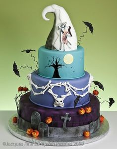 Nightmare.  This is the cutest and coolest Halloween cake I've ever seen.  I love the colors... Wonder if I could do a halloween wreath out of these colors.  <3