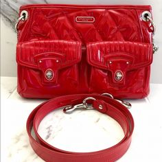 """COACH Red Patent Leather Bag Fun, bright red with silver hardware, patent leather handbag ❤️ Has a chain shoulder strap and removable crossbody strap. Has two exterior pockets, one interior zippered pocket and two interior open pockets. Bag was gently used and only has a few discoloration marks - one under the coach emblem on the front and a couple on the back. All are pictured above. The hardware and inside is in great condition! Bag measures 11.5"""" x 8"""" No trades, reasonable offers welcome…"""