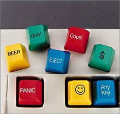 """Computer Key Caps  Price: Set of 8 for $19.99    Who couldn't use a """"panic"""" button? Or a """"beer"""" key? Stick these Computer Key Caps, which have a double-sided tape base, in a colleague's cube and brighten up their typing."""