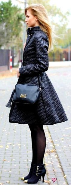Really elegant textured black coat with black and gold heels