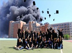 Students in China throwing their graduation caps into the air as their dormitory burns.