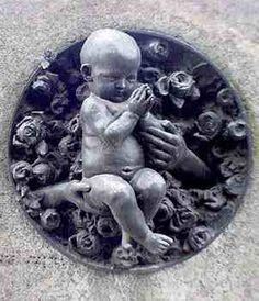 Many sculptures of children are at the Il Monumental Cimitero in Milan, Italy - photo from www3.sympatico (click on Cemeteries)