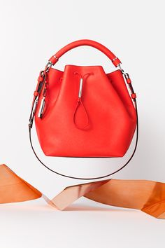 Make her season bright with the Galey saffiano leather bucket bag in red from Calvin Klein.
