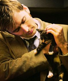 most adorable thing ever....Holding a kitten. << :')