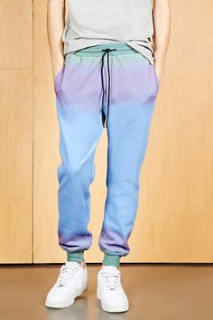 A pair of fleece knit sweatpants by Dope™ featuring an elasticized waistband with contrast drawstring, front slip pockets, banded leg cuffs, and an ombre effect along the waist and cuffs.  Matching hoodie available.