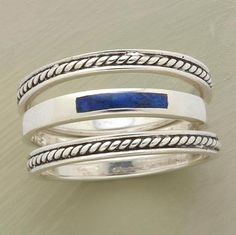 ROPED LAPIS RING TRIO--A pair of roped sterling bands reins in a third, inlaid with a narrow strip of blue lapis. Sundance exclusive. Set of 3
