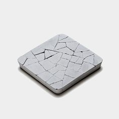 """This concrete coaster ($12) is water absorbent and """"heavy enough that it won't stick to your glass."""""""