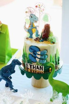 Take a look at this awesome dinosaur birthday party! The cake is so cool! See more party ideas and share yours at CatchMyParty.com #catchmyparty #partyideas #dinsoaur #dinosaurparty #boybirthdayparty