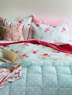 red and aqua. Florals. Polka dots (this is pretty much my ideal bed)