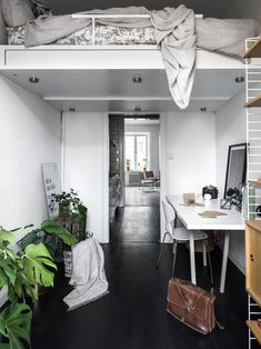 Bedroom with loft bed and workspace