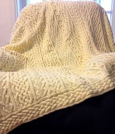This is my original pattern for a one-of-a-kind heirloom afghan. The pattern contains several traditional Irish knitting motifs - fancy twisted cables, nested hearts, bobbles, and braids. This project is knit in 5 pieces and seamed together at the end for a beautiful bedspread or large throw.