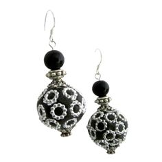 Price :$5.99 Ethnic Elegant Handmade Bead Holiday Gift Silver 92.5 Hook Earrings Material Used : Exotic Black polymer hard clay bead decorated with round silver metal all over accented with black pearl & daisy spacer dangling from Sterling Silver 92.5 Hook  Color : Black/Silver  Earrings Length : 1 1/2 inches from sterling silver 92.5 hook  Earrings Type : Sterling Silver 92.5 French Hook