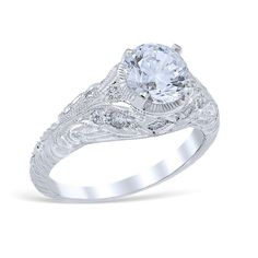 Filigree engagement ring showcasing horizontal bar and scroll work accented with hand engraved flore
