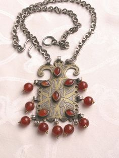 Antique Turkoman goldwash silver and carnelian pendant sold without chain