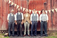 DIY Howell, Michigan Wedding; groomsmen in vests, different shades of gray