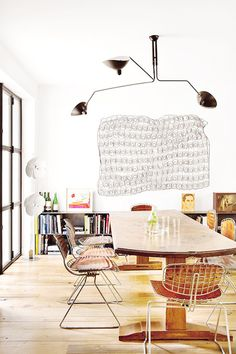 the classic 3-arm serge mouille light, via architectural digest espana / sfgirlbybay