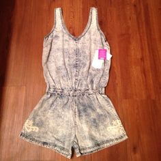 Acid wash jean romper Brand new with tags! Purchased from Dilliard's. Brand is Celebrity Pink. Has an elastic band around the waist and crochet detail on the side of the shorts. Retail price $45. Sizes small and medium available. Celebrity Pink Tops