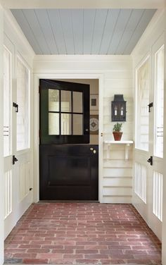 Covered screened porch with black farmhouse style entry door Brick flooring whit. Covered screened porch with black farmhouse style entry door Brick flooring white siding and blue b Modern Farmhouse, Farmhouse Style, Farmhouse Decor, Farmhouse Flooring, Farmhouse Renovation, Modern Porch, Style At Home, Blue Ceilings, Blue Porch Ceiling
