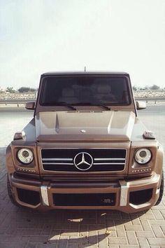 Gold Mercedes Benz AMG Wagon