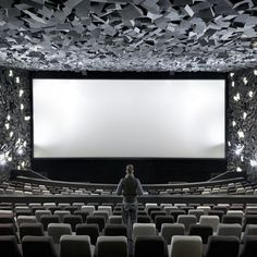 Virgina Lung explains how interior design firm One Plus Partnership used jagged geometric forms to create a cinema that looks like it has been blown up