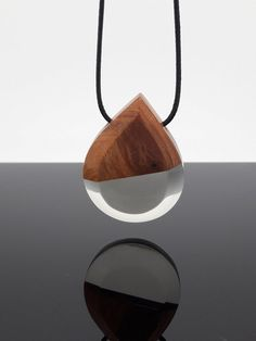 Teardrop shape pendant. Crystral clear resin and wood pendant necklace. Handmade jewelry by WoodAllGood. #WoodAllGood