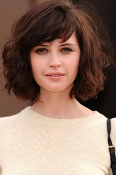 Felicity Jones | windswept bob, the bangs and the waves soften the look. Use a medium curling iron, take small sections from sides and curl toward the back. Spray, then open curls with your fingers, you can flip your head upside down to get a lot of texture.