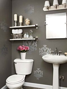 Shimmer and Shine. Put a little zing in your powder room with wall decals. Easy to apply and affordable, these pockets of pattern give this bathroom just the right amount of shimmer.