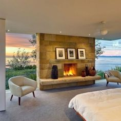 oh wow!!!  Fabulous bedroom with a fireplace and a view!