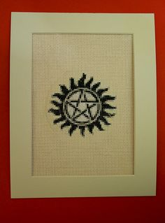 Anti-demon tattoo Supernatural cross stitch. This listing is for a finished piece. Wonder if they would sell a pattern. Hate to steal other's creative work, even for my own personal consumption.