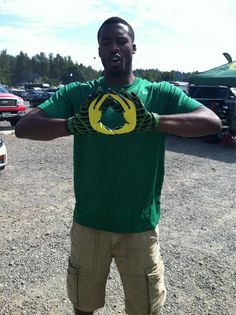 Wesley Matthews Throws Up The O Before UO's Game Vs. Fresno State On Sept. 8, 2012.