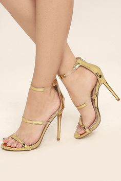 The Making Magic Gold High Heel Sandals create a sexy illusion that will have all your admirers mystified! Shiny, mirrored vegan leather forms these single sole heels with lucite accents along the strappy peep-toe upper. 3